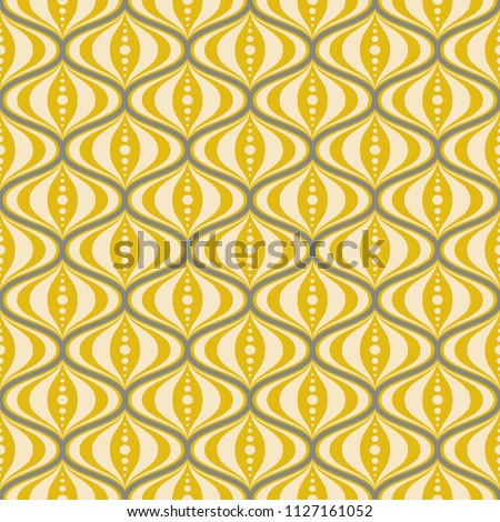 Mid-century retro seamless repeating groovy saucer pattern in yellow, cream, and grey