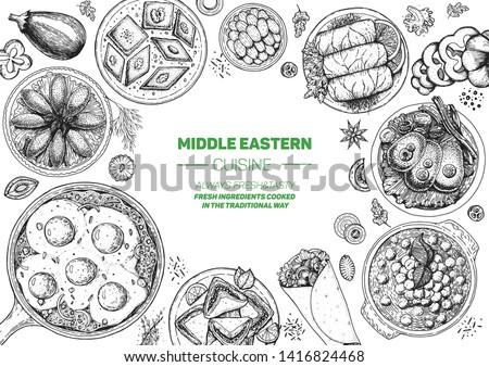 Middle eastern food top view frame. Food menu design with kibbeh, dolma, shakshouka, shawarma and sweets. Vintage hand drawn sketch vector illustration. #1416824468
