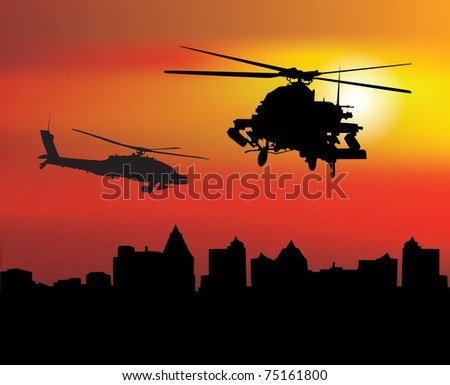 Military helicopters over the city at dawn