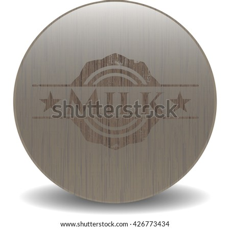 Milk badge with wooden background