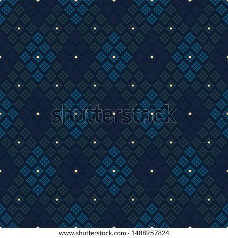 Modern argyle plaid pattern simplicity concept. Royal blue yellow green diamonds motif. Simple geometric allover print block for apparel textile, mens polo shirt, ladies dress fabric, fashion garment.