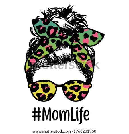 Mom with a Messy Bun, Momlife, Silhouette photo of a woman face with messy hair in a bun and long eyelashes. Stock photo ©