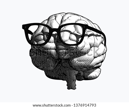 monochrome retro engraving human brain with black old glasses illustration in front view isolated on white background ストックフォト ©