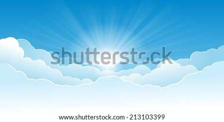 Morning sky with glowing clouds and rising sun with rays.