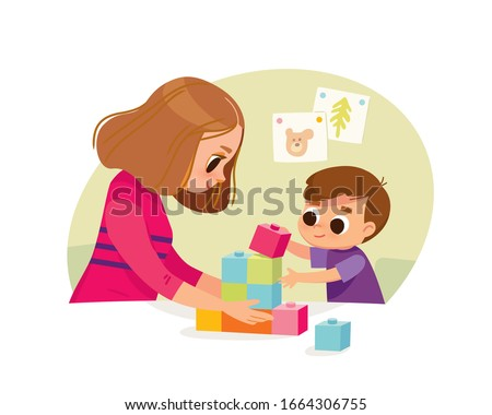 Mother playing with kid at home. Educational toys. Child playing designer cubes, developmental constructor.