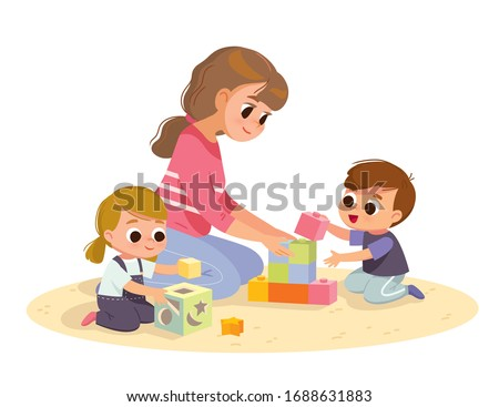 Mother playing with kids at home. Educational toys. Children playing designer cubes, developmental constructor, sorter.