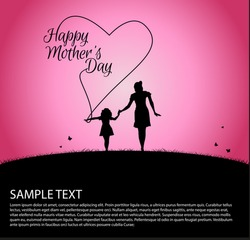 Mother silhouette with her baby on happy Mothers Day