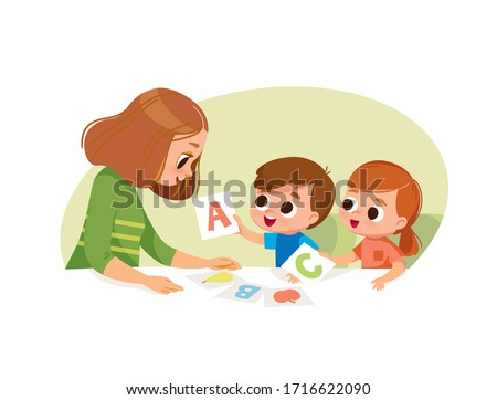 Mother with two kids. Early education. Learning alphabet with flashcards.