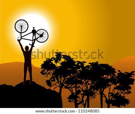 Mountain Biker holding bike above head in celebration