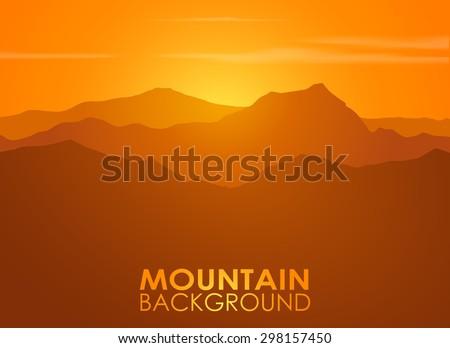 mountain range over sunset