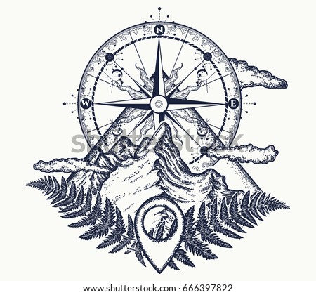 mountains and compass tattoo