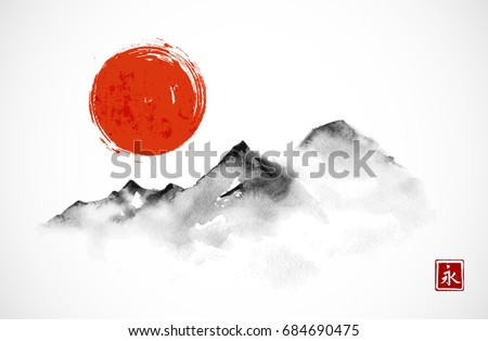 mountains and red sun hand