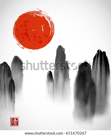 mountains in fog and red sun