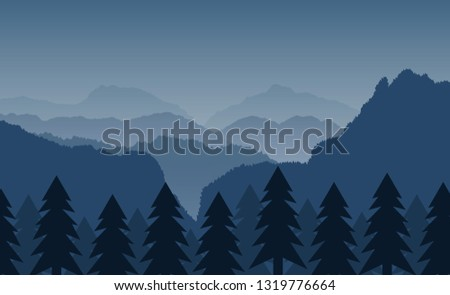 mountains with forest under