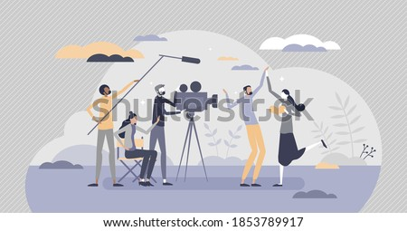 Movie making industry and cinematography filming process tiny person concept. Director, actors, producer and cameraman as creative motion pictures team vector illustration. Hollywood lifestyle scene. Foto stock ©