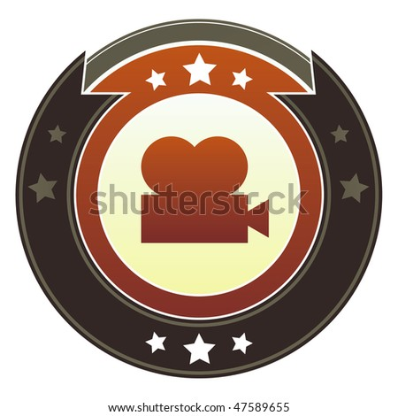 Movie or film projector icon on round red and brown imperial vector button with star accents suitable for use on website, in print and promotional materials, and for advertising.