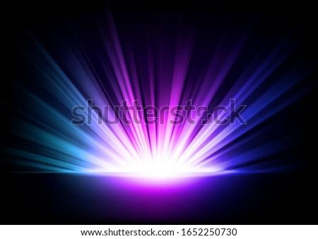 multicolor rays rising on dark