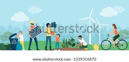 Multiethnic group choosing a sustainable eco-friendly lifestyle: people collecting and recycling waste in a park, growing plants and using renewable energies, ecology and cooperation concept