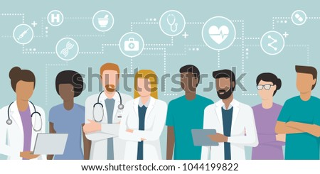 Multiethnic team of doctors and nurses working together, network of concepts on the top: healthcare and medicine