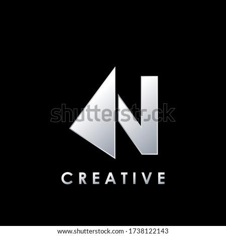 Multimedia Techno Split Half Letter N Logo Vector Design Template with geometric triangle arrow shape. Foto stock ©