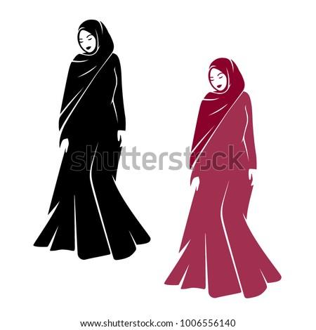 muslim woman standing in abaya