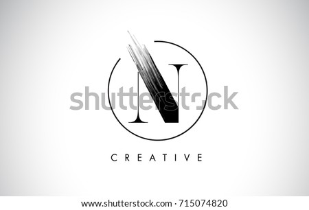 N Brush Stroke Letter Logo Design. Black Paint Logo Leters Icon with Elegant Circle Vector Design. Stock fotó ©