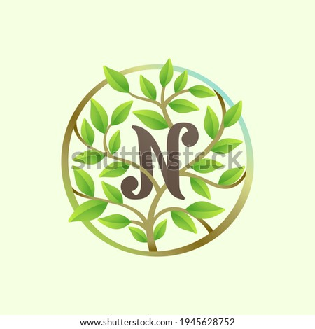 N letter logo made of twisted tree branches and green leaves in circle. Ecology vector font for vegan emblem, botanical identity, creative spring t-shirts, organic merchandise. Foto stock ©