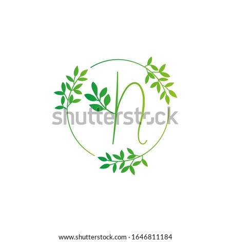 N letter logo vector design. N Icon eco green and circle concept template. N vector set of green eco letters logo with leaves. N alphabet of green leaves isolated on white background. Floral Alphabet. Foto stock ©