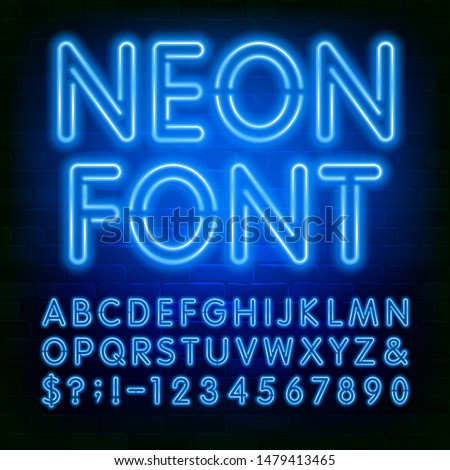 Neon alphabet font. Blue neon light bulb letters and numbers on brick wall background. Stock vector typeface for your typography design.