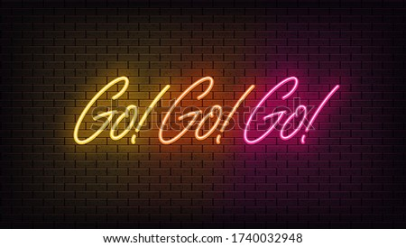Neon Go Go Go, lettering. Neon text of Go motivation on black brick background. Yellow, orange and pink vivid lights. Word, inscription and title with glow illumination. Vector illustration
