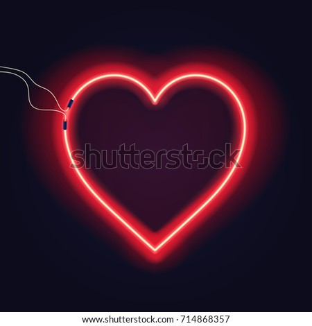 neon heart sign with wires on
