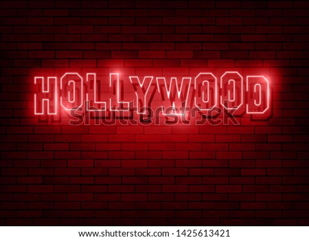 Neon Hollywood Text Vector with a Brick Wall Background, red light neon fashion design, Hollywood lighted sign isolated on dark night background, led lights style