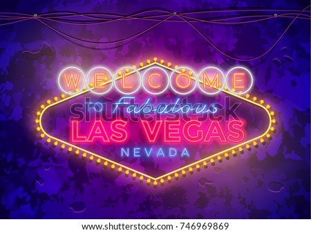 Neon Las Vegas Sign on urban street grunge wall.