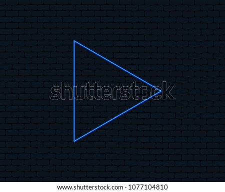 Neon light. Arrow sign icon. Next button. Navigation symbol. Glowing graphic design. Brick wall. Vector