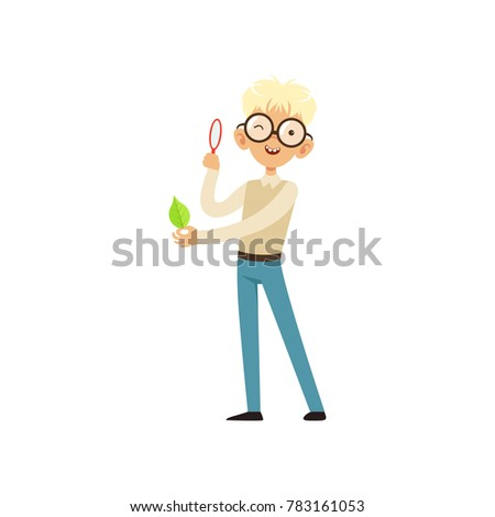 nerd boy looking at green leaf