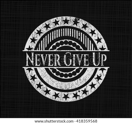Never Give Up written on a chalkboard