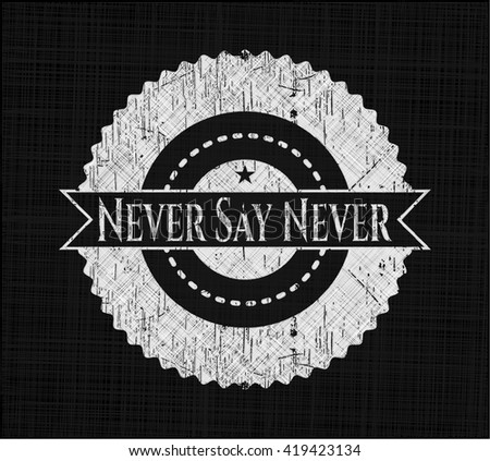 Never Say Never chalk emblem written on a blackboard