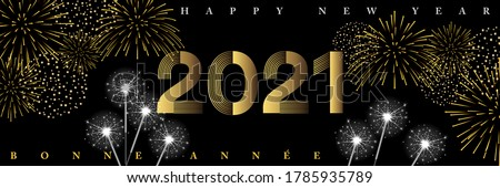 New Year's greetings 2021 - Night party mood banner with fireworks and sparklers - French, English text, translation: Happy New Year. stock photo