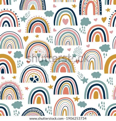 Nice baby neutral bohemian rainbows seamless pattern. Trend rainbows surface. Boho rainbows for baby shower invitations, cards, nursery room, posters, fabric. Vector patel bohemian rainbows on white.