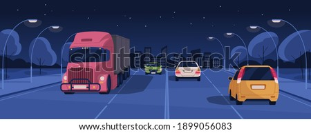 night driving in lit city