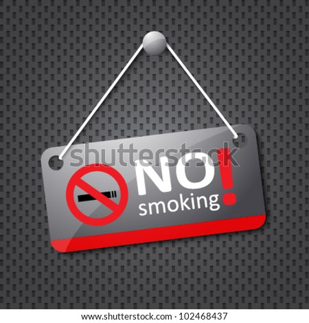 no smoking sign hanging on grey dotted texture
