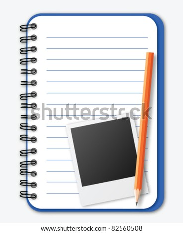 Notebook with photograph and pencil