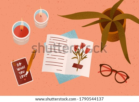 Notepad or diary with dry beautiful flower and writing text surrounded by cosiness things on desk vector flat illustration. Top view of cozy workplace organization with candles, accessories and plant Сток-фото ©