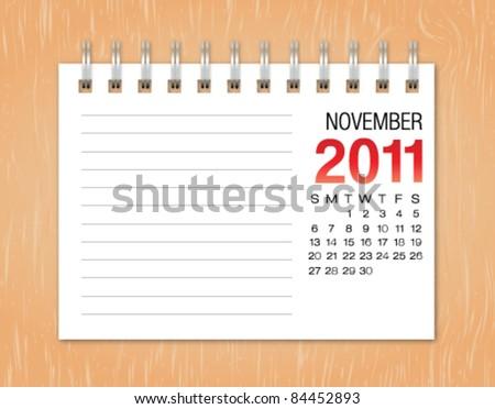 November month calendar 2011 on wood background