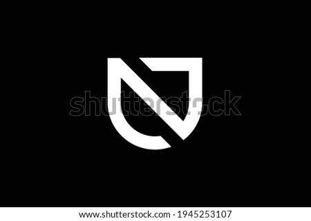 NU letter logo design on luxury background. UN monogram initials letter logo concept. NU icon design. UN elegant and Professional white color letter icon design on black background. Foto stock ©