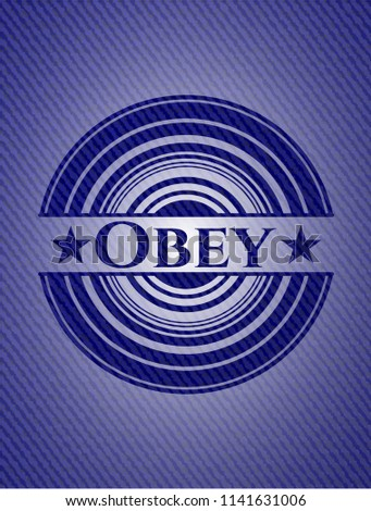 obey badge with denim background