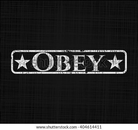 Obey written with chalkboard texture