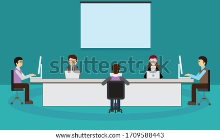 Office employees are maintaining social distance during the meeting and working together in meeting room. Office desk and tables are setup for safety prevention of covid-19, corona virus disease.