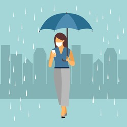 Office woman walking in the city while raining with umbrella in hand. She chatting with colleagues in mobile phone. Office lady wearing medical mask in public to prevent Covid-19 coronavirus disease.