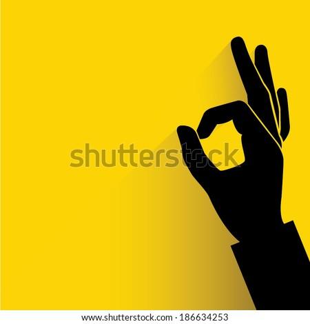 okay hand sign yellow background